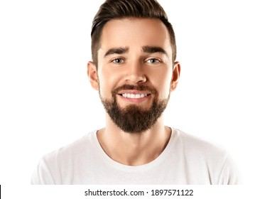 Portrait of young and handsome bearded man wearing white t-shirt