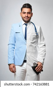 Portrait of a young handsome bearded man dressed as a businessman and as a doctor medicine healthcre vitality living profession occupation success leadership entrepreneur practitioner concept.