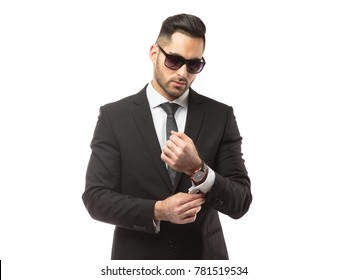 Portrait of young and handsome business man isolated on white background