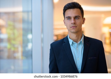 Portrait of young handsome businessman exploring the city of Bangkok,Thailand