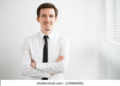 Portrait of young handsome businessman in a modern office