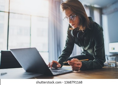 Portrait of Young handsome businesswoman using laptop computer at modern office.Blurred background