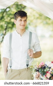 Portrait of a young handsome groom outdoors. fine art photography