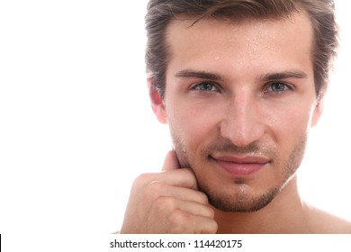 Portrait of young and handsome guy with water drops on his face
