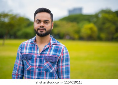 Portrait Of Young Handsome Indian Man In Park