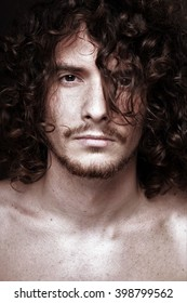 portrait of a young handsome man with curly hair