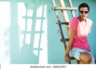 Portrait of a young handsome man, fashion model,  in urban background
