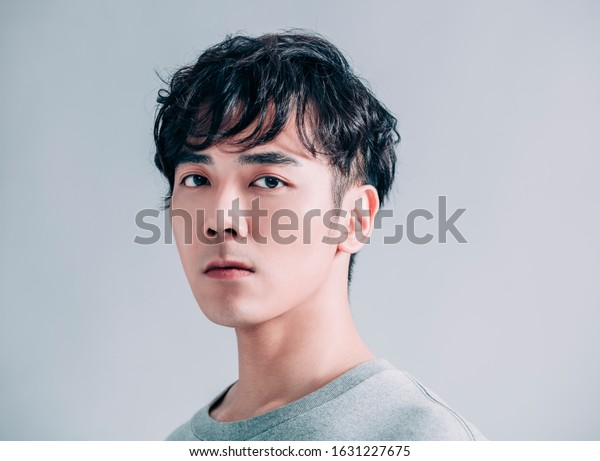 portrait of young  handsome man isolated on gray background