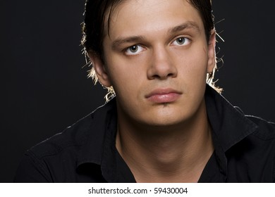 Portrait of young handsome man looking at camera