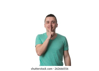 Portrait Of Young Handsome Man Quiet Gesture With Finger - Isolated On White Background