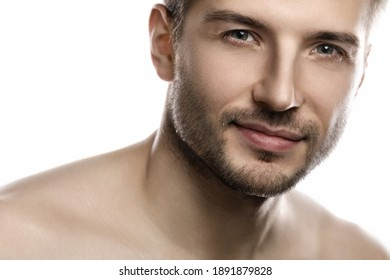 Portrait of young and handsome man with smooth skin posing on white background