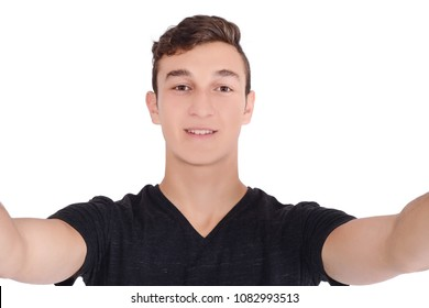 Portrait of a young handsome man taking a selfie. Isolated white background.