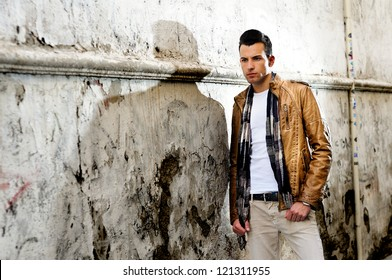Portrait of a young handsome man in urban background
