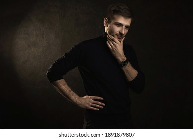 Portrait of young handsome man wearing a polo neck