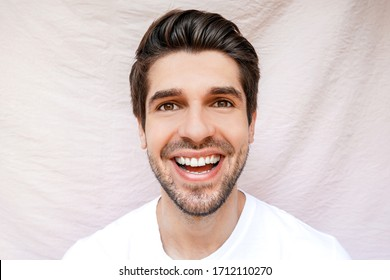 Portrait of a young handsome man with a wide open big smile