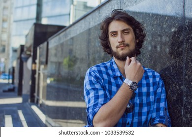 Portrait of young handsome stylish man on the street.