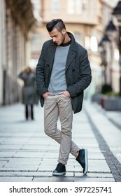 Portrait Of Young Handsome Stylish Man In Elegant Coat Outdoor Fashion