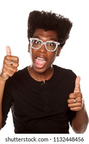 Portrait of young happy african american modern man with glasses on white background