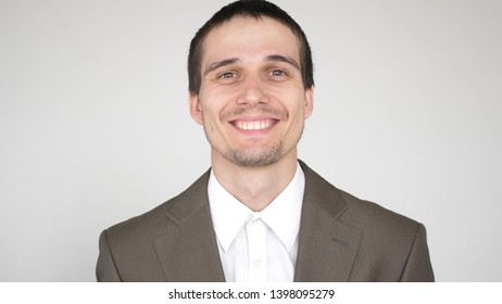 portrait of young happy attractive successful businessman on a white background