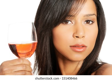 Portrait of young happy beautiful woman with glass of rose wine