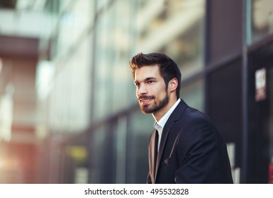 Portrait of a young happy businessman outside the office building