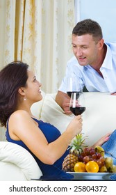 Portrait of young happy couple in domestic environment