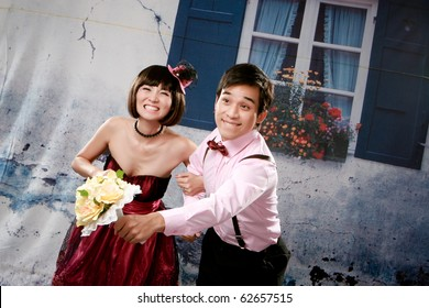 Portrait of young happy couple in lovely action