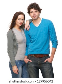 Portrait of a young happy couple standing against white background