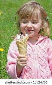 Portrait of young happy  girl  eating ice-cream