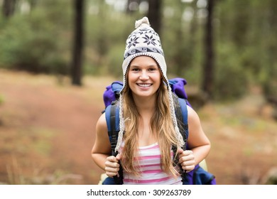 Portrait of a young happy hiker in the nature