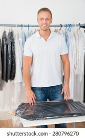 Portrait Of Young Happy Man Standing In Clothing Store