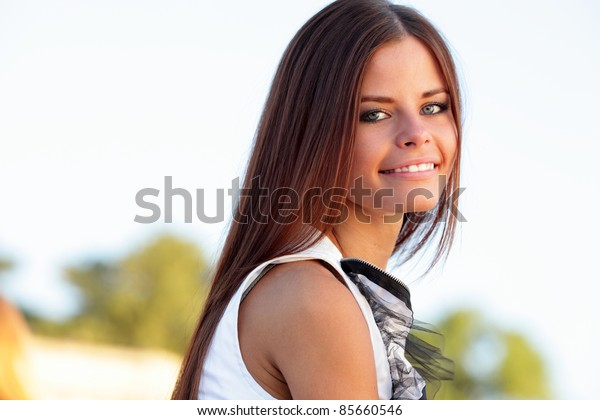Portrait of a young happy model outdoors