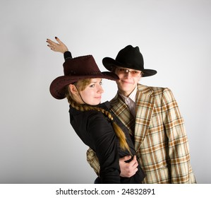 Portrait of young happy pair in cowboy's hats