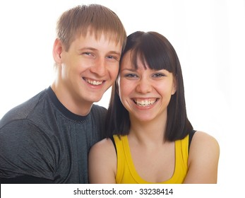 Portrait of young happy pair on a white background