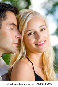 Portrait of young happy smiling amorous couple together, outdoors. Love, flirt, romantic, relations theme concept.