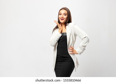 Portrait of young happy smiling businesswoman, isolated on white background.