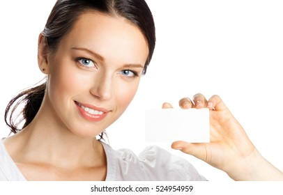 Portrait of young happy smiling businesswoman showing business or plastic card, isolated on white background