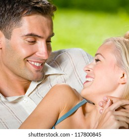 Portrait of young happy smiling cheerful attractive couple together, outdoors