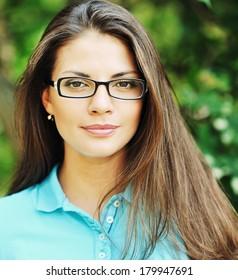 Portrait of young happy smiling cheerful woman in glasses