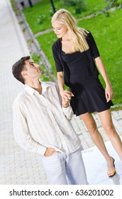Portrait of young happy smiling cheerful walking attractive couple together, outdoor. Love and relationships concept.
