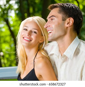 Portrait of young happy smiling cheerful attractive couple together, outdoors. Love, relationships and dating concept.