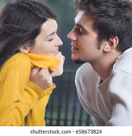 Portrait of young happy smiling cheerful couple outdoors. Love, relationships and dating concept.