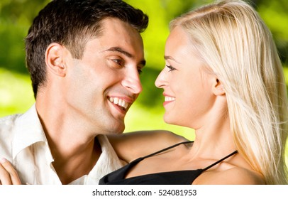Portrait of young happy smiling embracing; amorous couple together, outdoors. Love, flirt, romantic, relations theme concept.