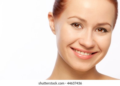 Portrait of young happy smiling woman on over white
