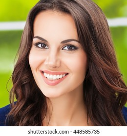 Portrait of young happy smiling young woman
