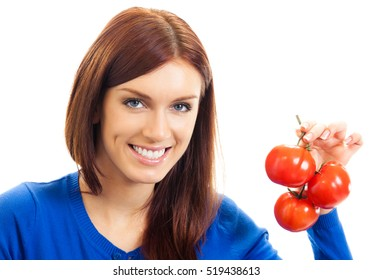 Portrait of young happy smiling woman with tomatoes, isolated on white background. Healthy eating and vegetarian dieting concept studio shot.