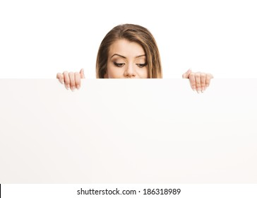 Portrait of young happy woman with blank advertising board or copy space, isolated on white