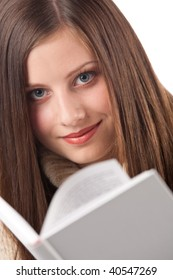 Portrait of young happy woman with book wearing turtleneck on white background