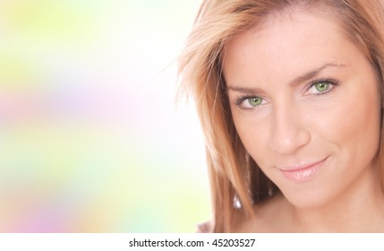 Portrait of a young happy woman over pastel background