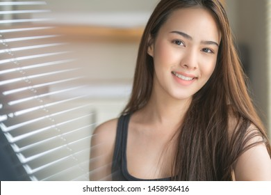 A portrait of Young healthy Asian woman with smiling.closeup face with clean skin